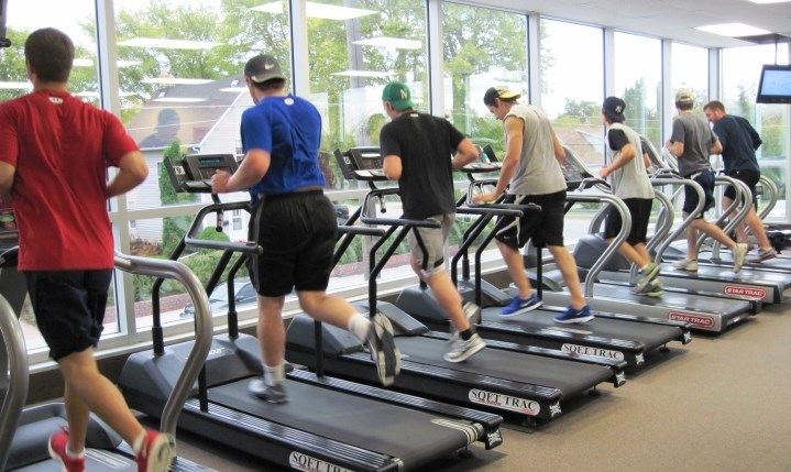 boys running on the treadmills