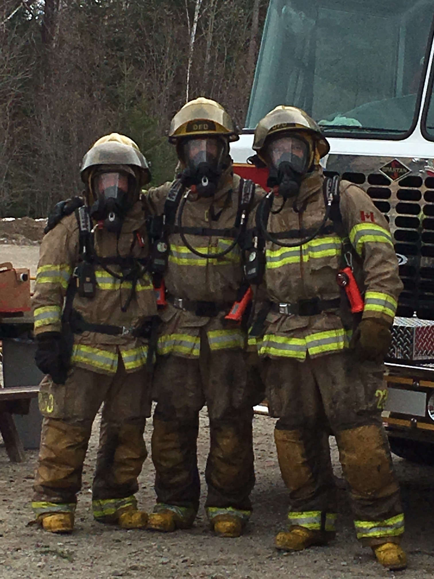 Photo of three firefighters at live fire training
