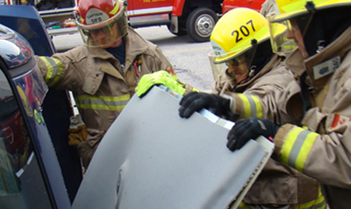 firefighters holding lid